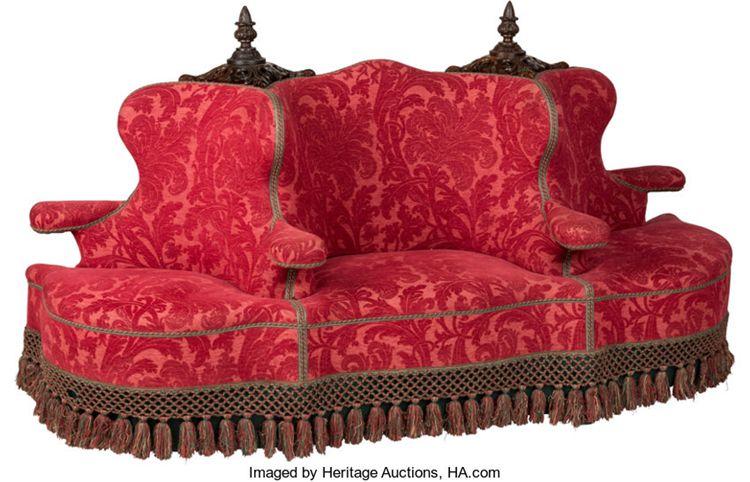 A Napoleon III Upholstered Canapé à Confidante Sofa, circa 1870.